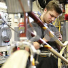 Monica Maschak - mmaschak@shawmedia.com<br /> Bike Mechanic Jacob Felckowski adjusts a rear derailleur at North Central Cyclery in downtown DeKalb. The owner of the Cyclery has recently purchased the Freeport Bicycle Company, which has been operating since 1933.
