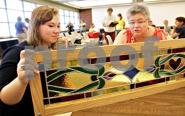 Monica Maschak - mmaschak@shawmedia.com<br /> Jaylene Jennings, 18, a ten-year member of 4-H, has her stained glass piece judged by Julie Sorensen during the judging day at the DeKalb County Farm Bureau Wednesday, July 17, 2013. 4-H, an organization by the University of Illinois Extension, is for children ages 8 to 18, that stands for head, heart, health and hands. Children explore different paths of creativity, make projects and have them judged.