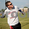 Monica Maschak - mmaschak@shawmedia.com<br /> Ben Lawson, 14, hurles a disc at a Prairie Runners practice at Huntley Middle School on Thursday, July 18, 2013. Lawson qualified for the Junior Olympics National Championships in the discus throw. The championships will begin on July 25.