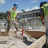 Monica Maschak - mmaschak@shawmedia.com<br /> Dave Schau and his coworkers, with Martam contruction Inc., build a center island for the entrance to the new DeKalb police facility on Tuesday, July 16, 2013. Temperatures in the area reached a high of 90 degrees Fahrenheit with humidity at 52 percent according to the National Weather Service.