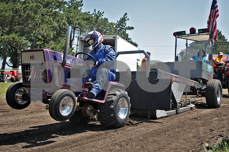 """Monica Maschak - mmaschak@shawmedia.com<br /> Herb Sawallisch pops a wheelie in his """"What's Next"""" tractor in the initial pull of a 1100-pound weight during the garden tractor pull at the Waterman Lions Club 13th Annual Summer Fest at Waterman Lions Park on Saturday, July 20, 2013. Sawallisch and his tractor pulled the weight 169.44 feet."""