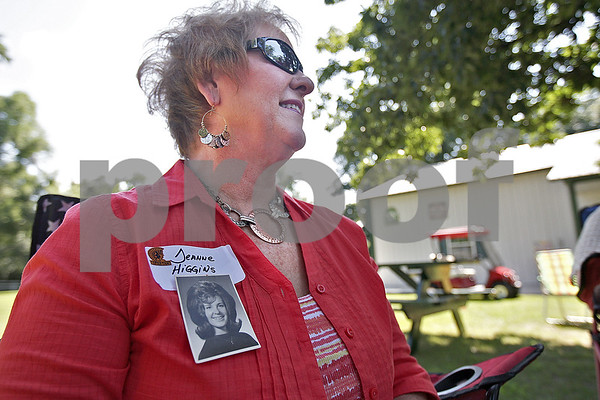 Monica Maschak - mmaschak@shawmedia.com<br /> Jeanne Higgins, class of 1965, wears her class photo under her name tag at a Baby Boomer Bash for Sycamore High School graduates from the 1960s held at the Criswell residence in Genoa on Saturday, July 13, 2013. The baby boomers have a reunion every two years.