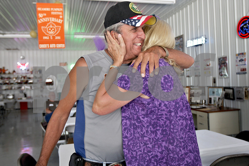 Monica Maschak - mmaschak@shawmedia.com<br /> George Spartz, class of 1958, hugs long-time friend Donna Barnaby, class of 1968, at a Baby Boomer Bash for Sycamore High School graduates from the 1960s held at the Criswell residence in Genoa on Saturday, July 13, 2013. The baby boomers have a reunion every two years.