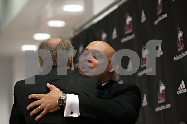 Rob Winner – rwinner@shawmedia.com<br /> <br /> Northern Illinois University President Douglas Baker (left) hugs newly introduced director of athletics Sean Frazier during a press conference at the Yordon Center on the NIU campus in DeKalb, Ill., Tuesday, July 16, 2013.