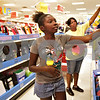 Monica Maschak - mmaschak@shawmedia.com<br /> Tamia Hughes, 12, and her mother, Vickie Hughes, pick out school supplies at the Target in DeKalb on Wednesday, July 17, 2013. Tamia will be starting her seventh grade year at Sycamore Middle School on August 21.