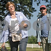 Monica Maschak - mmaschak@shawmedia.com<br /> Kathy Weeden Johnson and Steve Mitchell, both class of 1968, play a game of bags at a Baby Boomer Bash for Sycamore High School graduates from the 1960s held at the Criswell residence in Genoa on Saturday, July 13, 2013. The baby boomers have a reunion every two years.
