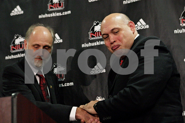 Rob Winner – rwinner@shawmedia.com<br /> <br /> Northern Illinois University President Douglas Baker (left) shakes hands with newly introduced director of athletics Sean Frazier during a press conference at the Yordon Center on the NIU campus in DeKalb, Ill., Tuesday, July 16, 2013.