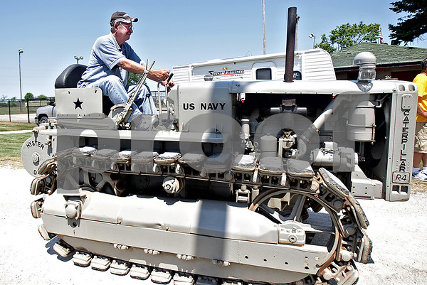 Monica Maschak - mmaschak@shawmedia.com<br /> Jim Gletty, of Somonauk drives his 1944 Caterpillar R4 Military in the tractor and truck Parade of Power at the Waterman Lions Club 13th Annual Summer Fest at Waterman Lions Park on Saturday, July 20, 2013.