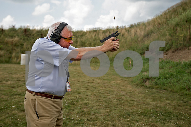 Monica Maschak - mmaschak@shawmedia.com<br /> Safer USA President David Lombardo fires away at a target with an XDS Springfield Armory 45mm hand gun at the Aurora Sportsman Club firing range in Waterman on Thursday, July 18, 2013. This hand gun is a typical concealed carry gun, because of its small size.