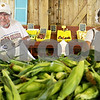 Monica Maschak - mmaschak@shawmedia.com<br /> Bob Tamblyn, of DeKalb, and Kathy Coppert, of Maple Park, bag ears of corn the first day of sweet corn sales at Wiltse Farm in Maple Park on Wednesday, July 17, 2013. The sweet corn will be freshly picked daily.