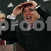 Rob Winner – rwinner@shawmedia.com<br /> <br /> The newly introduced director of athletics Sean Frazier (right) puts on a NIU cap after being introduced by President Douglas Baker during a press conference at the Yordon Center on the NIU campus in DeKalb, Ill., Tuesday, July 16, 2013.