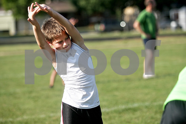 Monica Maschak - mmaschak@shawmedia.com<br /> Jack Cambier, 10, stretches before a Prairie Runners practice at Huntley Middle School on Thursday, July 18, 2013. Cambier qualified for the Junior Olympics National Championships in the 800 meter run. The championships will begin on July 25.