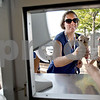 Monica Maschak - mmaschak@shawmedia.com<br /> Beth Ager, of DeKalb, reaches for her thin mint custard as her daughter, Anne Ager, 8, digs into her frozen dessert at Ollie's Frozen Custard on Tuesday, July 16, 2013. Temperatures in the area reached a high of 90 degrees Fahrenheit with humidity at 52 percent according to the National Weather Service.