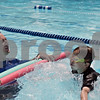 Rob Winner – rwinner@shawmedia.com<br /> <br /> Jason Akst, of Sycamore, closes his eyes as his son, William Akst, 7, jumps into the Sycamore Park District Pool on Monday, July 15, 2013.