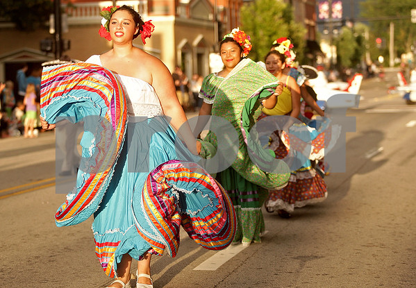 Monica Maschak - mmaschak@shawmedia.com<br /> Samantha Torres, 16, with the Rietos del Sol, whirls her skirt as part of the Kishwaukee Fest Parade in Downtown DeKalb on Friday, July 26, 2013.