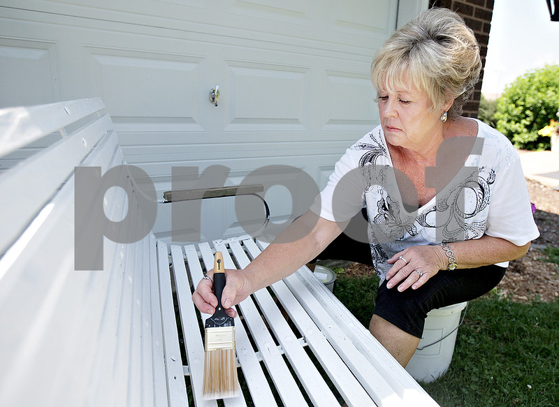 Monica Maschak - mmaschak@shawmedia.com<br /> Dianne Gautcher, of Sycamore, works around her house on Thursday, July 18, 2013. A retired NIU employee, Gautcher said she sometimes worries about how her and her husband will manage if they have to deal with some kind of medical emergency.