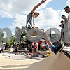 Monica Maschak - mmaschak@shawmedia.com<br /> Grant Katula, 16, of Wheaton, skids across the mini ramp at Skate Street in Van Buer Plaza Wednesday, July 24, 2013.