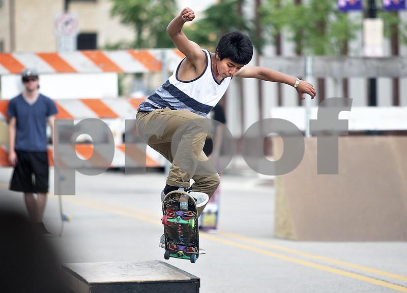 Monica Maschak - mmaschak@shawmedia.com<br /> Luis Fulgencilo, 14, jumps onto a box at Skate Street in Van Buer Plaza Wednesday, July 24, 2013.