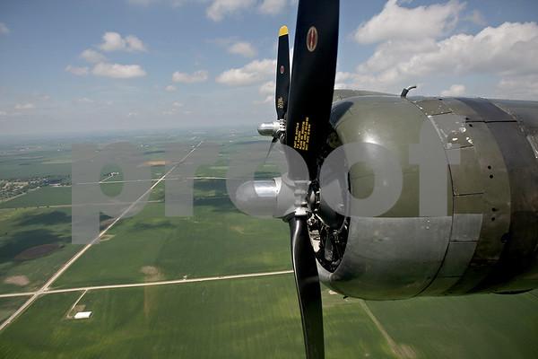 Monica Maschak - mmaschak@shawmedia.com<br /> B-17G Bomber Flying Fortress propellers over the green land of DeKalb County.