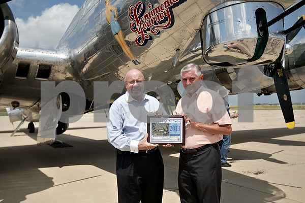 Monica Maschak - mmaschak@shawmedia.com<br /> State Representative Bob Pritchard presents DeKalb Mayor John Ray with an Airport of the Year Award at the DeKalb Taylor Municipal Airport on Monday, July 22, 2013.
