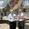 Monica Maschak - mmaschak@shawmedia.com<br /> State Representative Bob Pritchard presents DeKalb Mayor John Ray with an Airport of the Year Award at the DeKalb Taylor Municipal Airport on Monday, July 22, 2013.