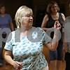 Rob Winner – rwinner@shawmedia.com<br /> <br /> Judy Bryant enjoys herself during a line dancing class in the basement of the Sycamore Veterans Club in Sycamore, Ill., Monday, July 1, 2013.