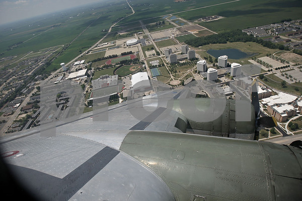 Monica Maschak - mmaschak@shawmedia.com<br /> The Northern Illinois University campus is seen off the the left wing of the B-17G Bomber Flying Fortress, during a flight over DeKalb County on Monday, July 22, 2013. The Bomber is on display at the DeKalb Taylor Municipal Airport through Sunday.