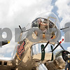 Monica Maschak - mmaschak@shawmedia.com<br /> Caroline Lowery reaches to open a small window in the nose of the B-17G Bomber Flying Fortress before take off on Monday, July 22, 2013. The Bomber is on display at the DeKalb Taylor Municipal Airport through Sunday.