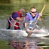 Monica Maschak - mmaschak@shawmedia.com<br /> Kurt and Jason Harjong paddle away on their low-floating Angry Jays boat at the annual Kardboard Regatta at the Kingston Township Park on Saturday, July 20, 2013.