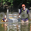 Monica Maschak - mmaschak@shawmedia.com<br /> Max and his dad, Troy Sieroslawski, their S.S. Humble back to shore after capsizing at the annual Kardboard Regatta at the Kingston Township Park on Saturday, July 20, 2013.