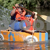 Monica Maschak - mmaschak@shawmedia.com<br /> Jack and Carly Fischer race their Cog Mobile to the finish line at the annual Kardboard Regatta at the Kingston Township Park on Saturday, July 20, 2013. The Cog Mobile won in the head-to-head race.
