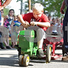 Monica Maschak - mmaschak@shawmedia.com<br /> Daymian Harvel, 7, pulls a weighted sled as far as he can on a pedal tractor at the Kirkland Festival on Independence day. The festival runs through Sunday, July 7. Harvel received first place in his age group for pulling the sled the furthest distance.