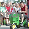 Monica Maschak - mmaschak@shawmedia.com<br /> Cameron Emerich, 7, of Kirkland gets fourth place in the pedal pull for his age group at the Kirkland Festival on Independence day. The festival runs through Sunday, July 7.