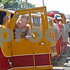 Monica Maschak - mmaschak@shawmedia.com<br /> Engineer Peter Robinson steps into the engine of the Waterman Western Railroad train after loading passengers at the Waterman Lions Club 13th Annual Summer Fest at Waterman Lions Park on Saturday, July 20, 2013.