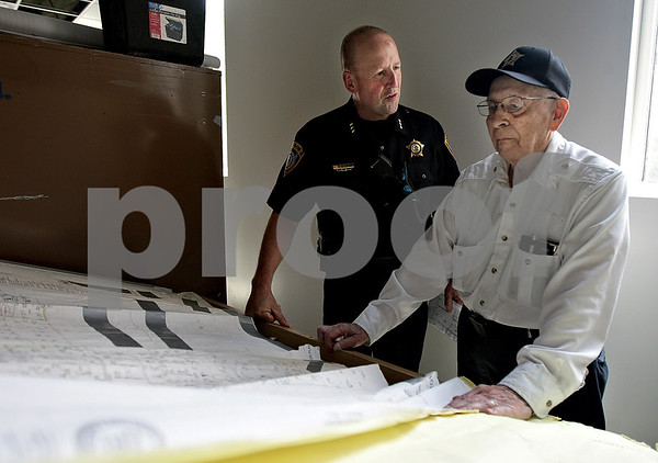 Monica Maschak - mmaschak@shawmedia.com<br /> City of DeKalb Police Chief Gene Lowery looks over blue prints with former DeKalb motorcycle cop Donald Schoo, 88, during a tour of the new police facility on Route 38 on Tuesday, July 16, 2013. Schoo, also World War II veteran, worked for the department 45 year ago.