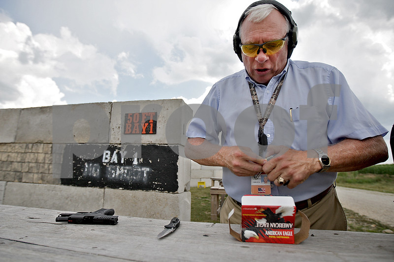 Monica Maschak - mmaschak@shawmedia.com<br /> Safer USA President David Lombardo loads an XDS Springfield Armory 45mm hand gun at the Aurora Sportsman Club firing range in Waterman on Thursday, July 18, 2013. This hand gun is a typical concealed carry gun, because of its small size.