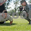 "Monica Maschak - mmaschak@shawmedia.com<br /> Tyler Fowler does pushups for two minutes as Sergeant Joe Valdez, future soldier leader, counts off during a physical assessment test for new United States Army recruits at Huntley Middle School on Thursday, June 26, 2013. ""I want to defend because the people who try to make the world worse don't take a day off,"" Fowler said, quoting Bob Marley."