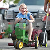Monica Maschak - mmaschak@shawmedia.com<br /> Marissa McMurray, 6, pedals as fast as she can on a toy-size tractor at the Kirkland Festival on Independence day. The festival runs through Sunday, July 7.