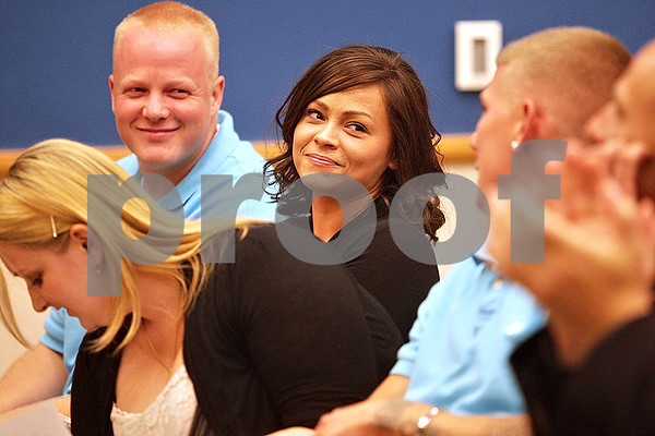 Monica Maschak - mmaschak@shawmedia.com<br /> Graduates Joshua Walker (left) and Jessica White share a laugh with Brad Cantrall after watching a short slideshow on their journey at the DeKalb County Drug/DUI Court Choosing Life and Ending Abuse Now (CLEAN) Program's tenth graduation ceremony on Friday, June 7, 2013. Eight members graduated from the program.