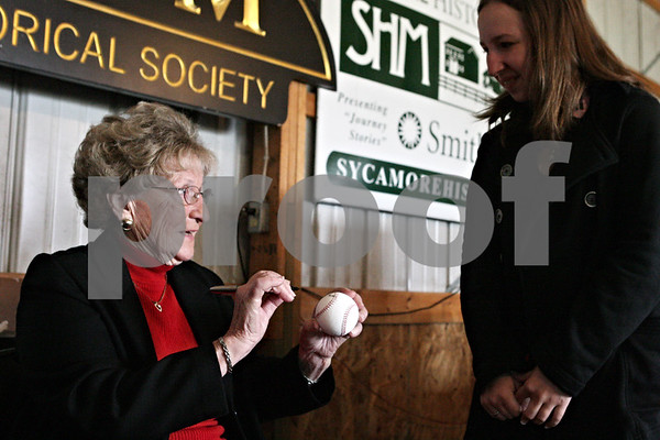 "Rob Winner – rwinner@shawmedia.com<br /> <br /> Sycamore resident Betty Mullins (left) signs a baseball for Lauren Dwyer, of Hampshire, before Thursday's Brown Bag Lunch event at the Sycamore History Museum featuring Mullins. Mullins was one of the women who played in the All-American Girls Professional Baseball League in 1948-49. ""I've always loved the AAGPBL,"" said Dwyer who played softball for nine years."