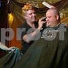 Stephanie Hickman - shickman@shawmedia.com  <br /> Joe Lamancuso of the Hair Cuttery shaves the head of Kerry Lilly Sunday at The House Cafe. Lilly was among six local volunteers who shaved their heads to support the St. Baldrick's charity for children battling cancer.