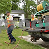 Rob Winner – rwinner@shawmedia.com<br /> <br /> Matt Dyson (left) and Steven Burke, of Genoa Public Works, spray for weeds near the railroad tracks on North State Street in Genoa, Ill., Tuesday, June 4, 2013.