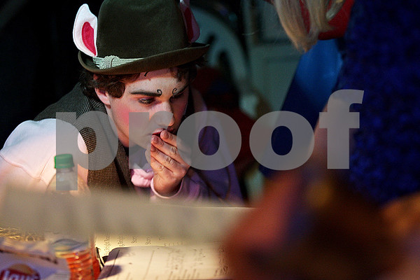 Monica Maschak - mmaschak@shawmedia.com<br /> Dominic Johnson, one of the Three Little Pigs, looks at a run sheet backstage during a dress rehearsal for Shrek the Musical at Stage Coach Player in Dekalb on Tuesday, June 4, 2013. The show opens on Thursday, June 6 and run through June 16.