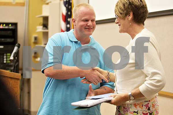 Monica Maschak - mmaschak@shawmedia.com<br /> Joshua Walker, 31, accepts his graduation certificate from Judge Robbin Stuckert at the DeKalb County Drug/DUI Court Choosing Life and Ending Abuse Now (CLEAN) Program's tenth graduation ceremony on Friday, June 7, 2013. He began the program when he was arrested in 2011 after struggling with addiction for 15 years. Walker, now two years sober, was one of eight members to graduate from the program. He currently works two jobs and has plans to start his own business.