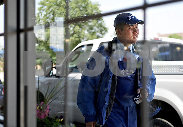 "Monica Maschak - mmaschak@shawmedia.com<br /> David Roberts, 27, returns to the restaurant after running an order to a customer at Culver's in Sycamore on Thursday, June 6, 2013. Roberts, who is developmentally disabled, has been running food to Culvers' indoor and outdoor customers for nine years. Rain or shine ""he never complains,"" Culver's Manager Amanda Corona said."