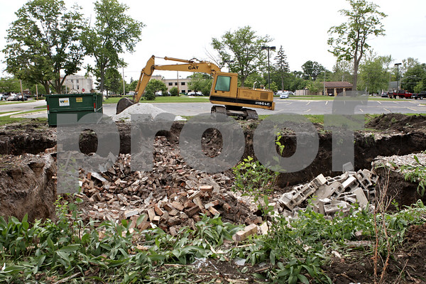 Rob Winner – rwinner@shawmedia.com<br /> <br /> A house at the corner of East Exchange North Walnut streets in Sycamore was demolished to make room for the county's jail expansion project as seen on Tuesday, June 4, 2013.