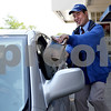 Monica Maschak - mmaschak@shawmedia.com<br /> David Roberts, 27, runs an order to a customer at Culver's in Sycamore on Thursday, June 6, 2013. Roberts, who is developmentally disabled, has been running food to Culvers' indoor and outdoor customers for nine years.