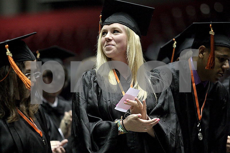 Monica Maschak - mmaschak@shawmedia.com<br /> Emma Fillmore applaudes her family during the DeKalb High School commencement ceremony at the Northern Illinois University Convocation Center on Saturday, June 8, 2013. About 350 students graduated.