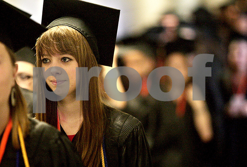 Monica Maschak - mmaschak@shawmedia.com<br /> Sarah Jilek files into the auditorium during the DeKalb High School commencement ceremony at the Northern Illinois University Convocation Center on Saturday, June 8, 2013. About 350 students graduated.