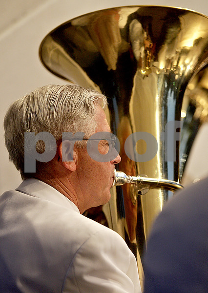 Monica Maschak - mmaschak@shawmedia.com<br /> Dave Peterson plays his tuba during a performance by the DeKalb Municipal Band at the Dee Palmer Bandshell in Hopkins Park on Tuesday, June 11, 2013.